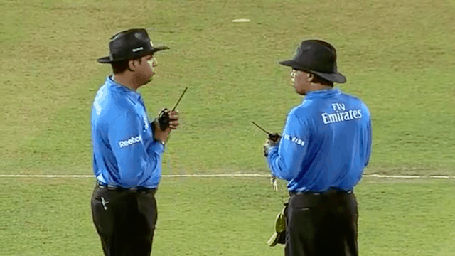 Umpires Discussing a suspected bowling action