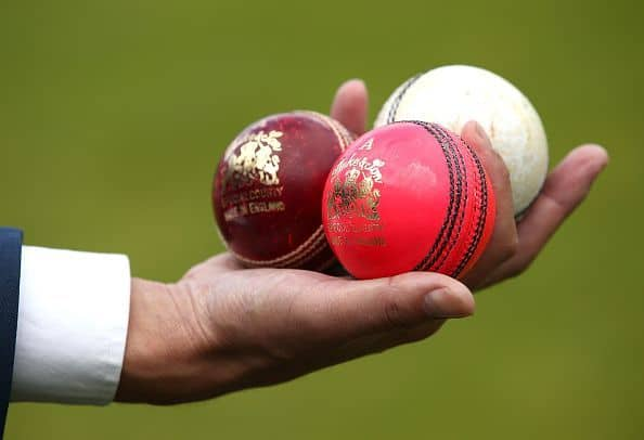 red white and pink cricket balls